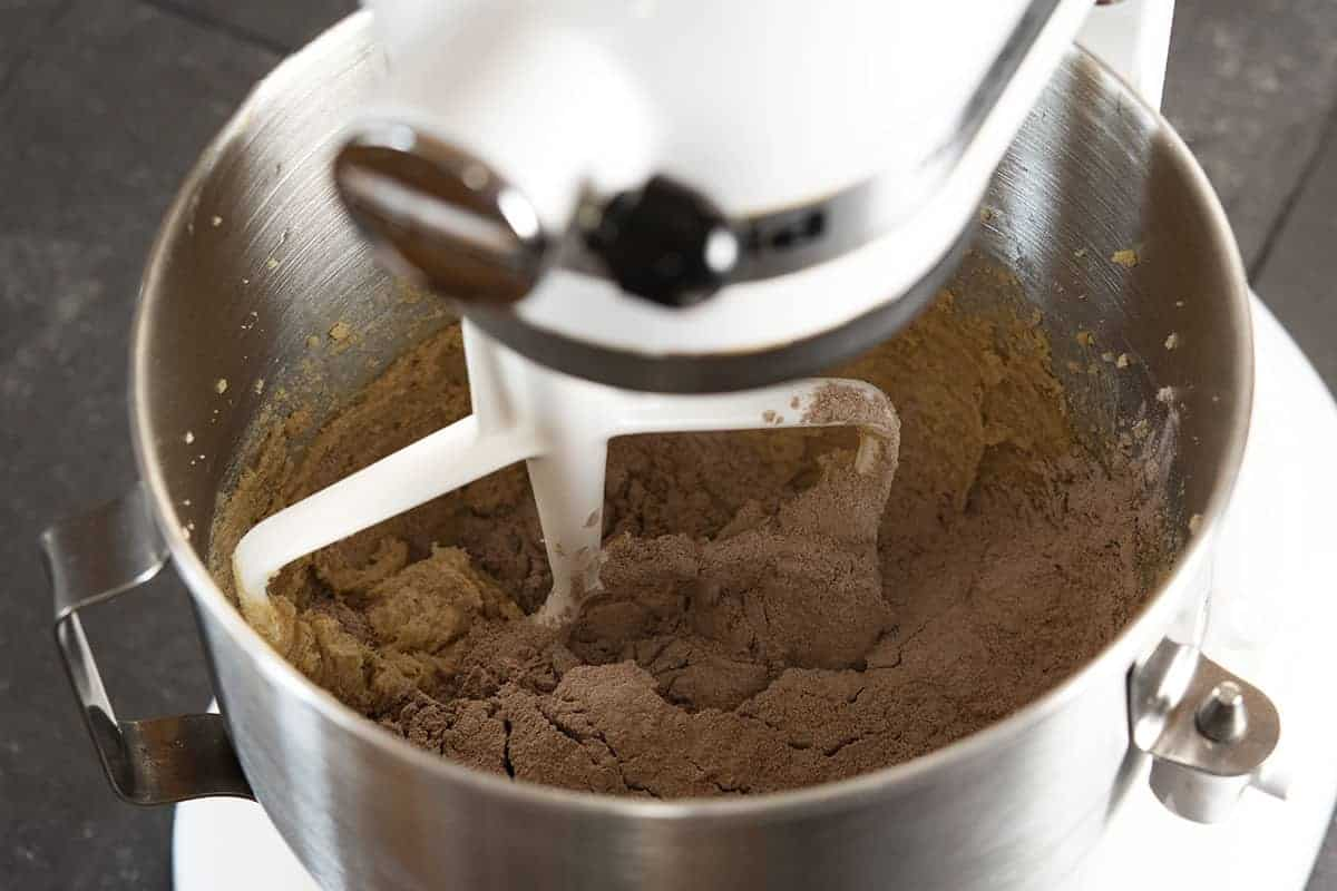adding dry ingredients to wet in stand mixer bowl