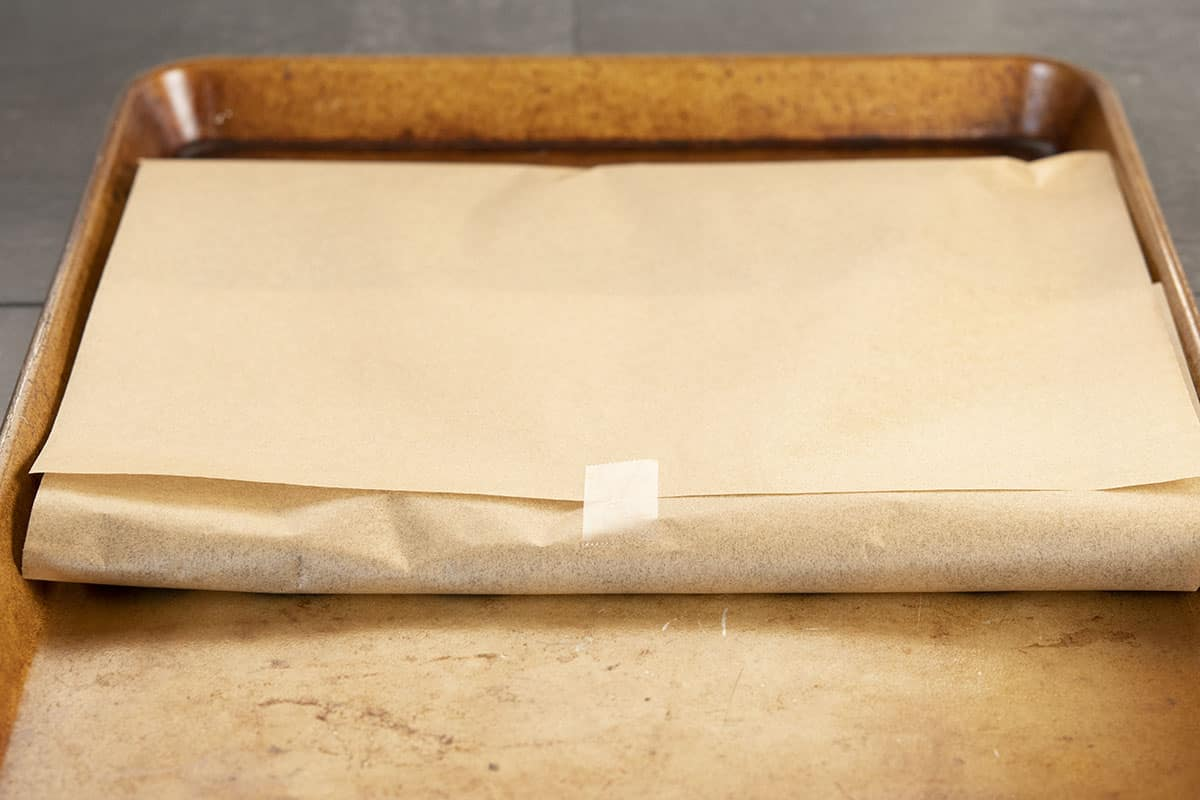 cut out cookies wrapped in parchment paper ready to refrigerate or freeze
