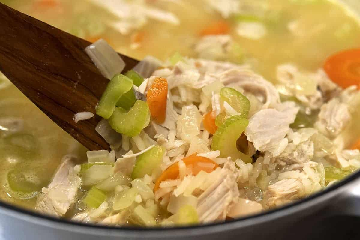 stirring turkey and rice soup