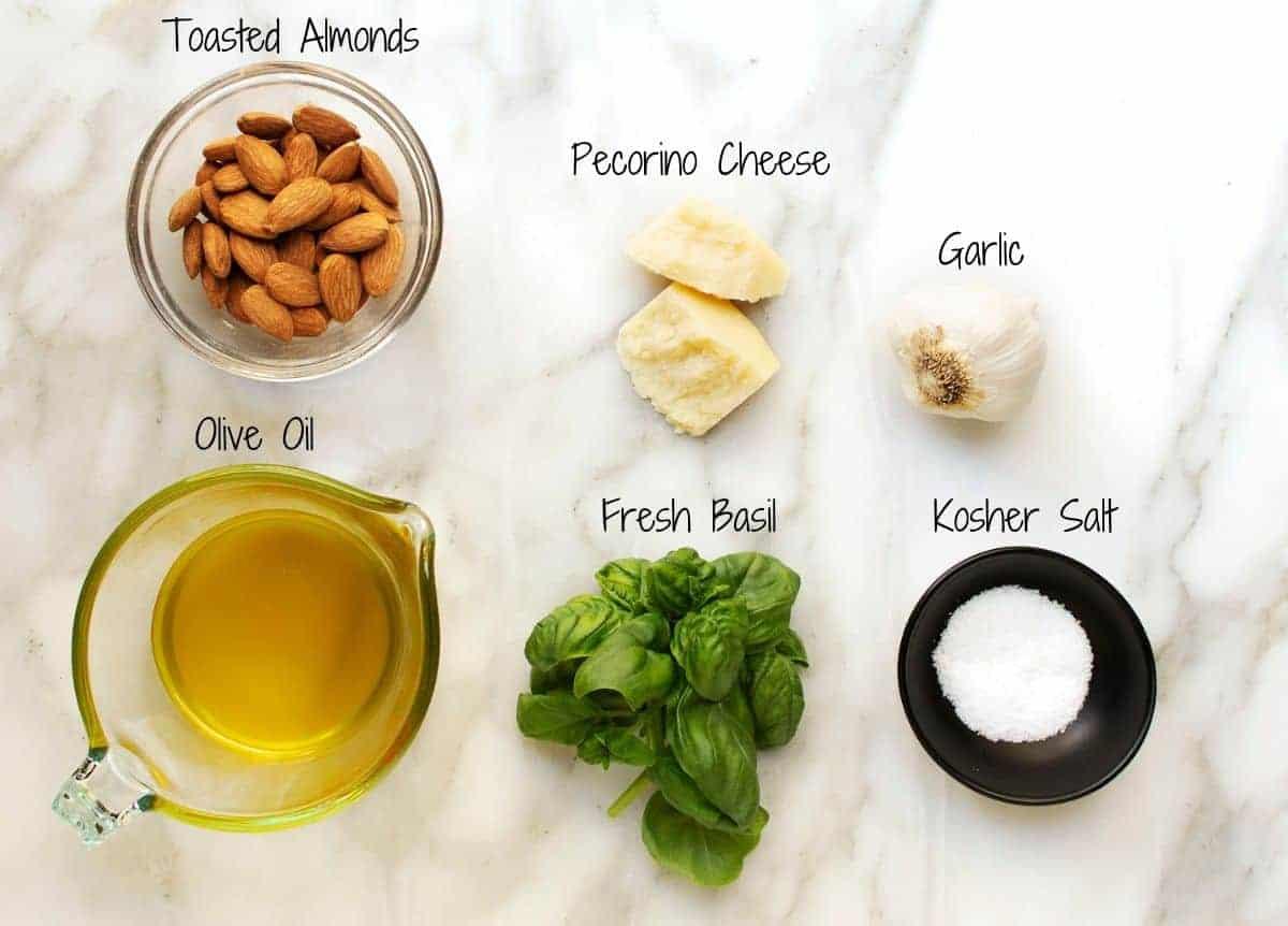 Almond Pesto Ingredients on a white marble board