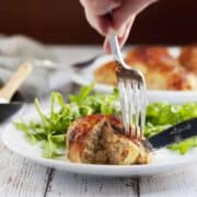 cutting Chicken Ballotine with fork and knife