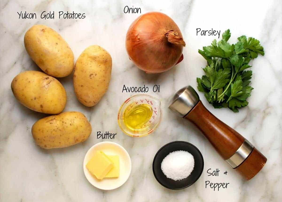 Lyonnaise Potatoes Ingredients on a white marble board