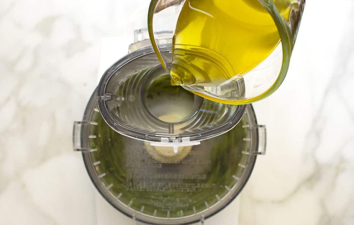 adding olive oil through food processor shoot