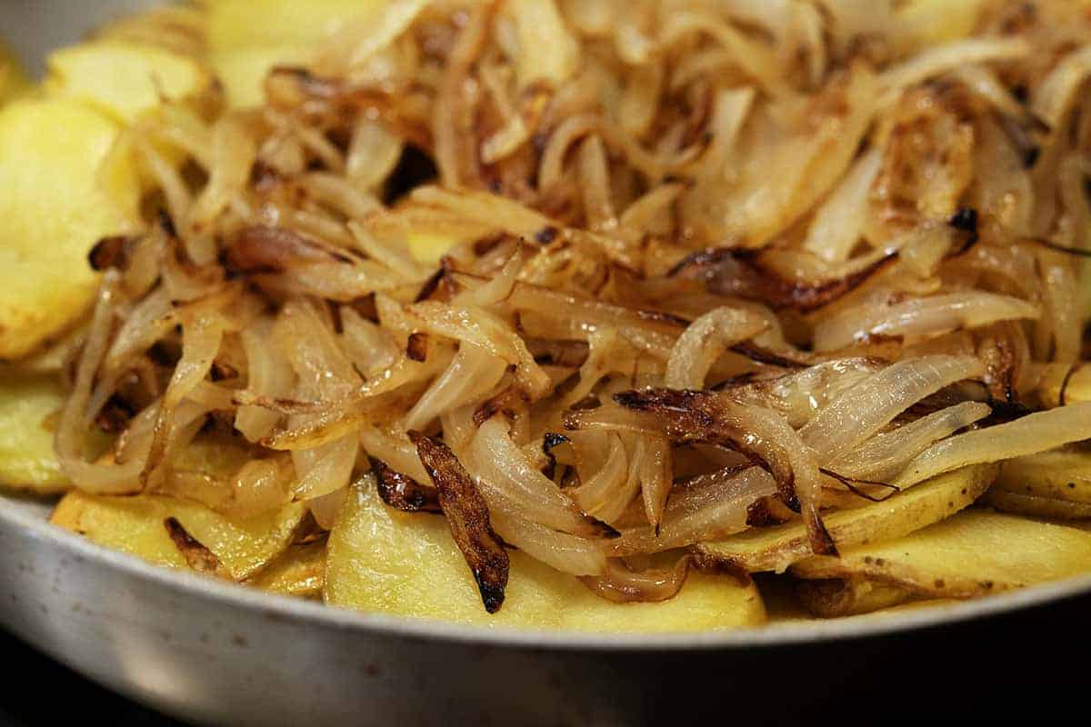 caramelized onions added to pan fried potatoes
