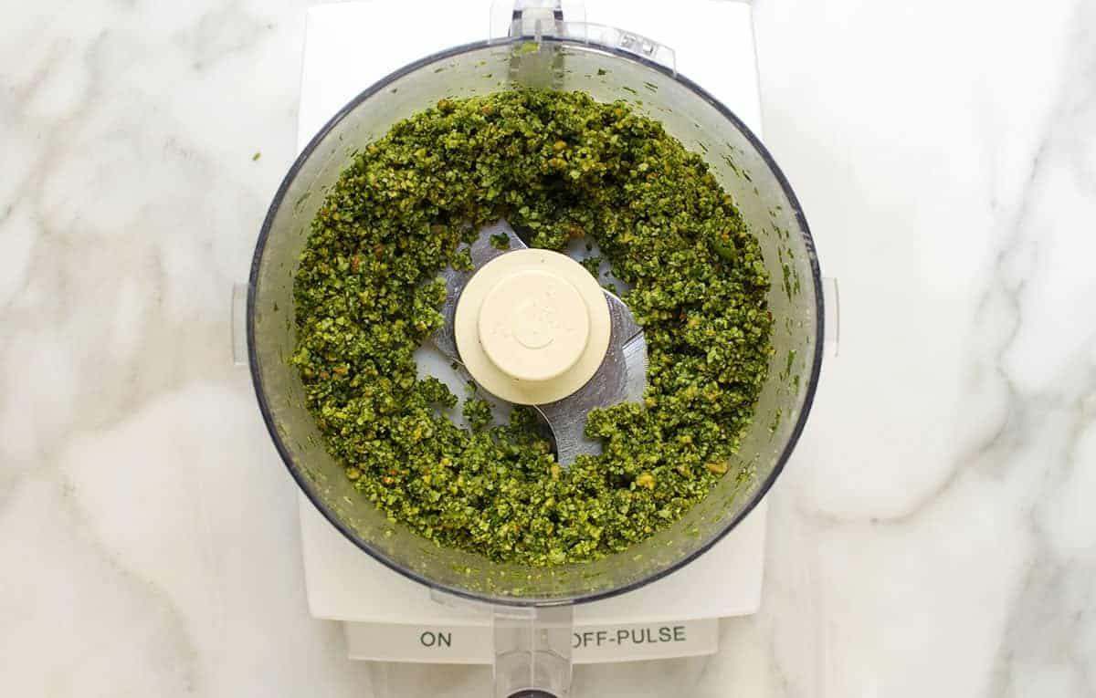 minced almonds basil and garlic in food processor