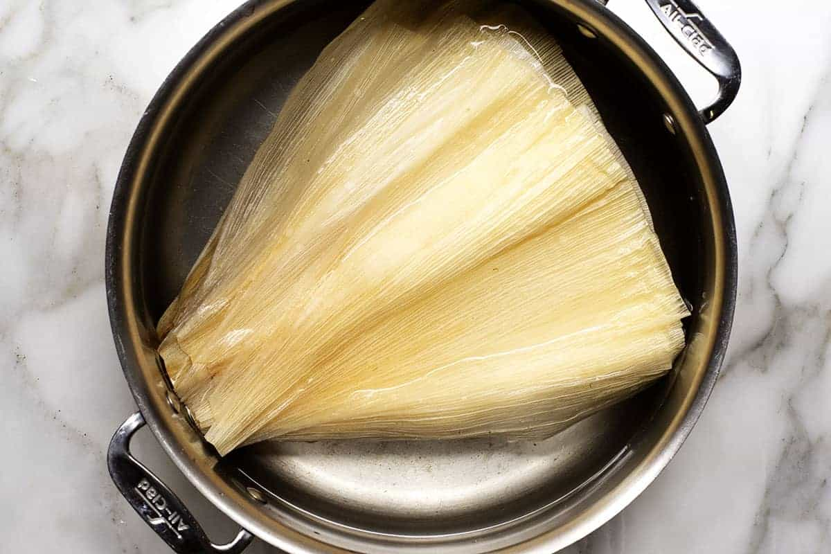 soaking dry corn husks in water
