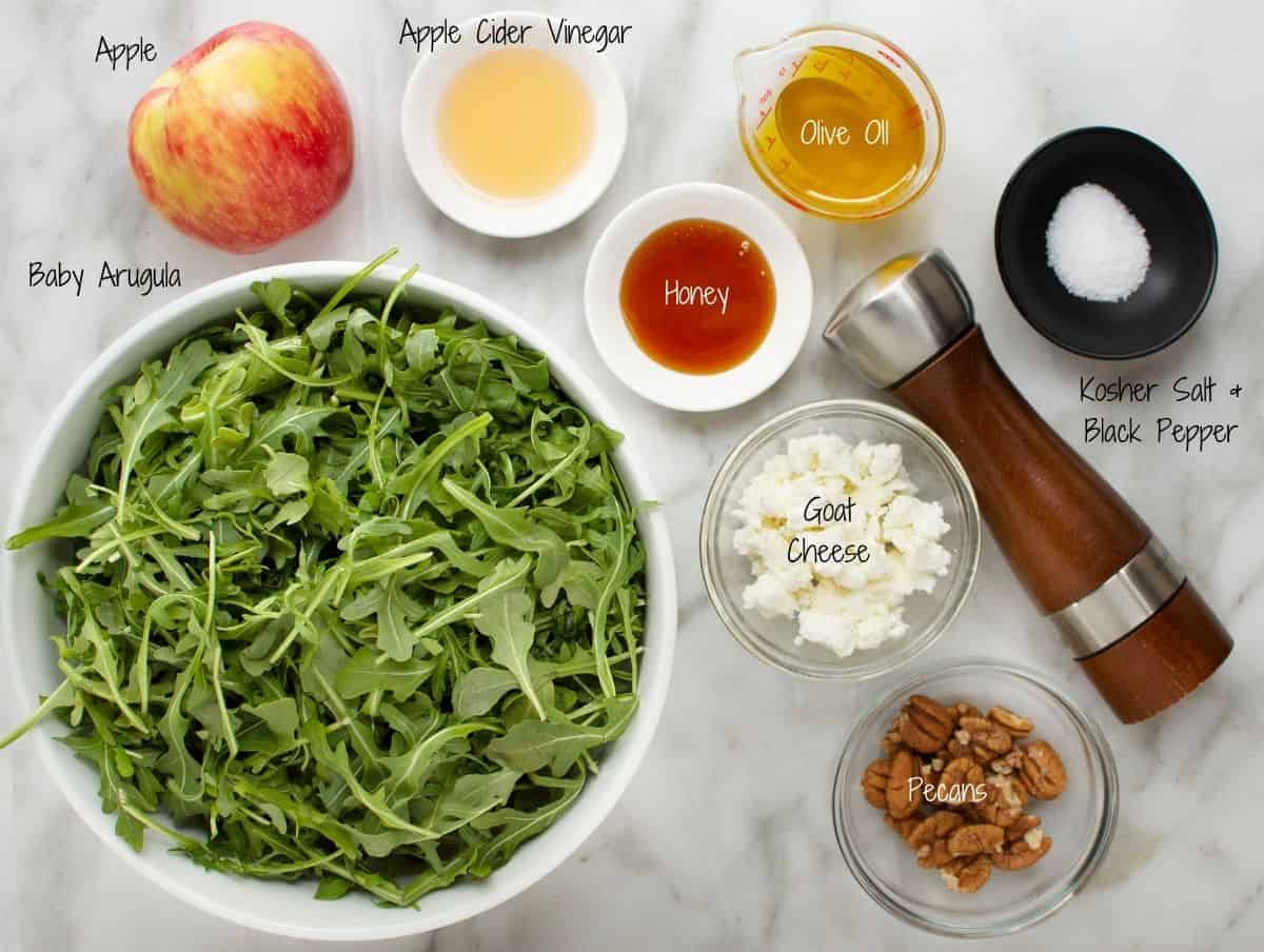 Arugula Apple Salad Ingredients on a white marble board