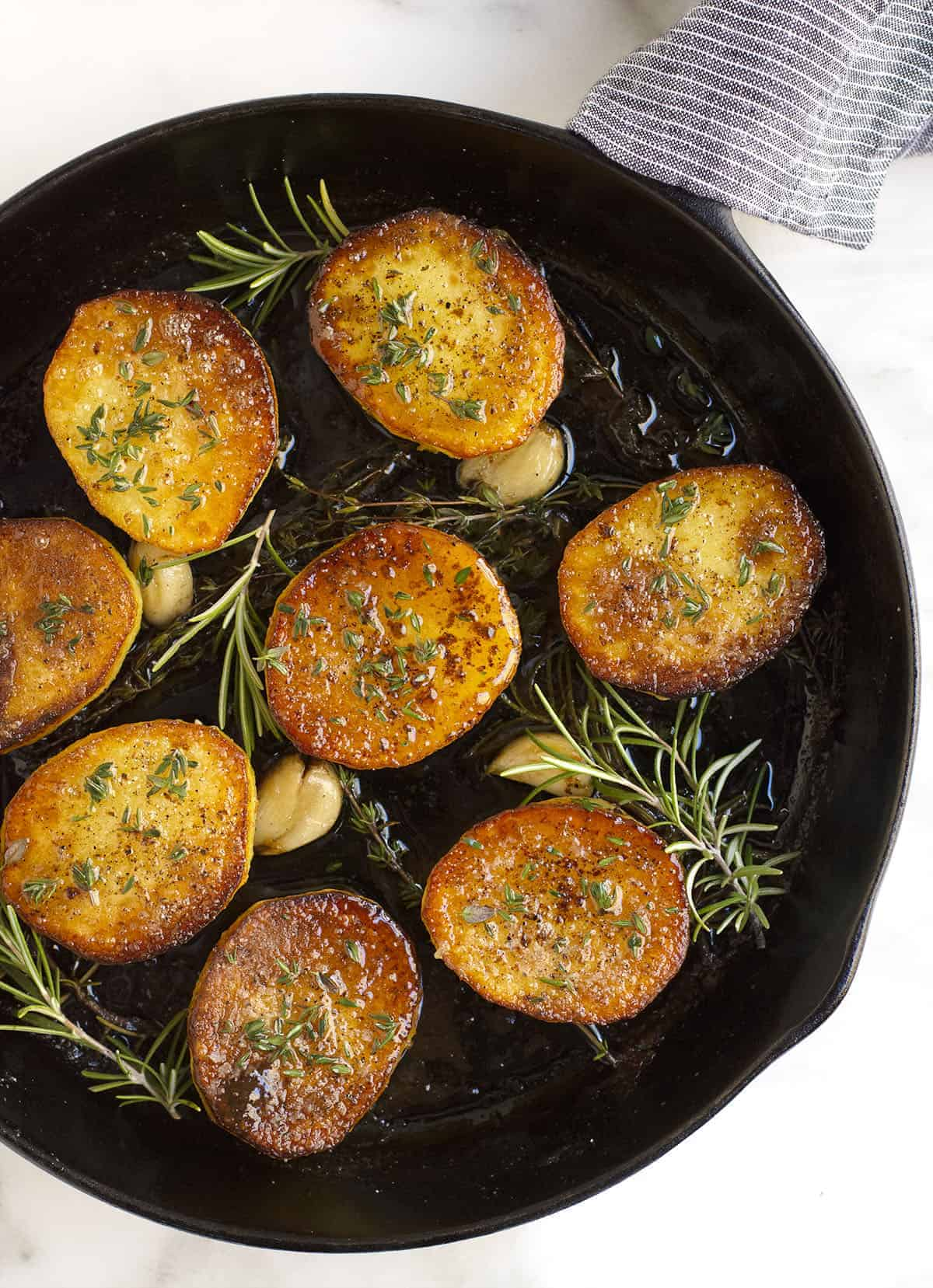Fondant Potatoes in a cast iron skillet photographed from above