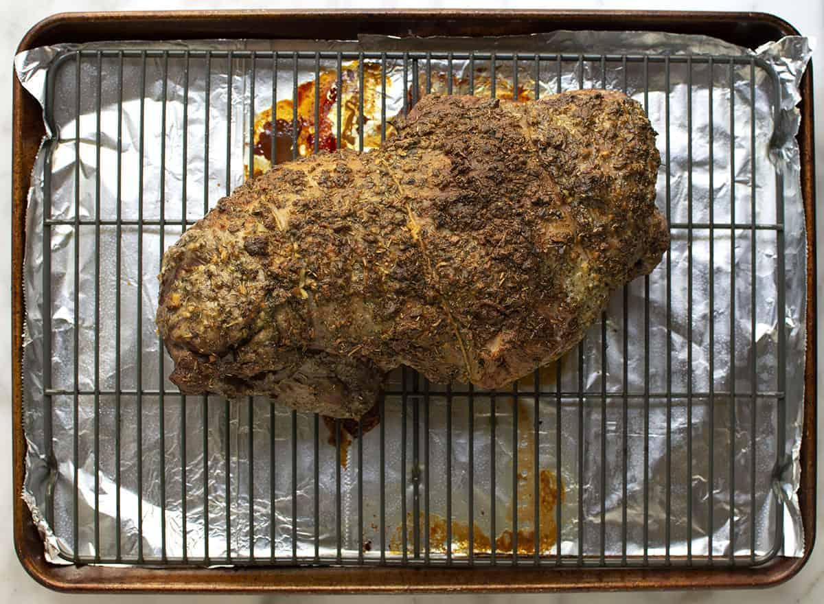 Roasted Boneless Leg of Lamb on rack in rimmed baking sheet