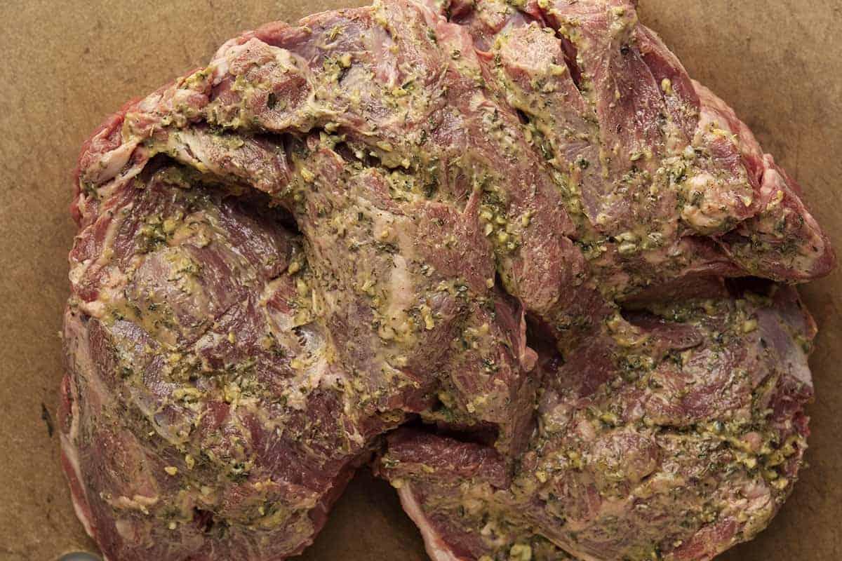 boneless leg of lamb underside rubbed with herb paste
