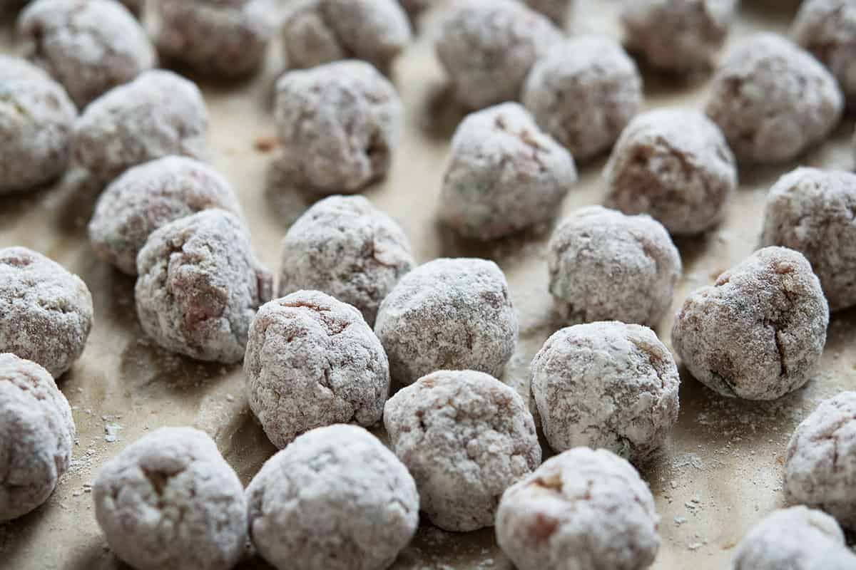 raw meatballs lightly coated in flour