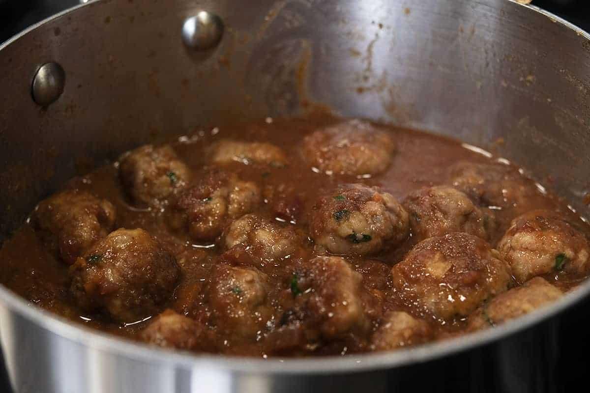 spanish meatballs in sauce in saucepan
