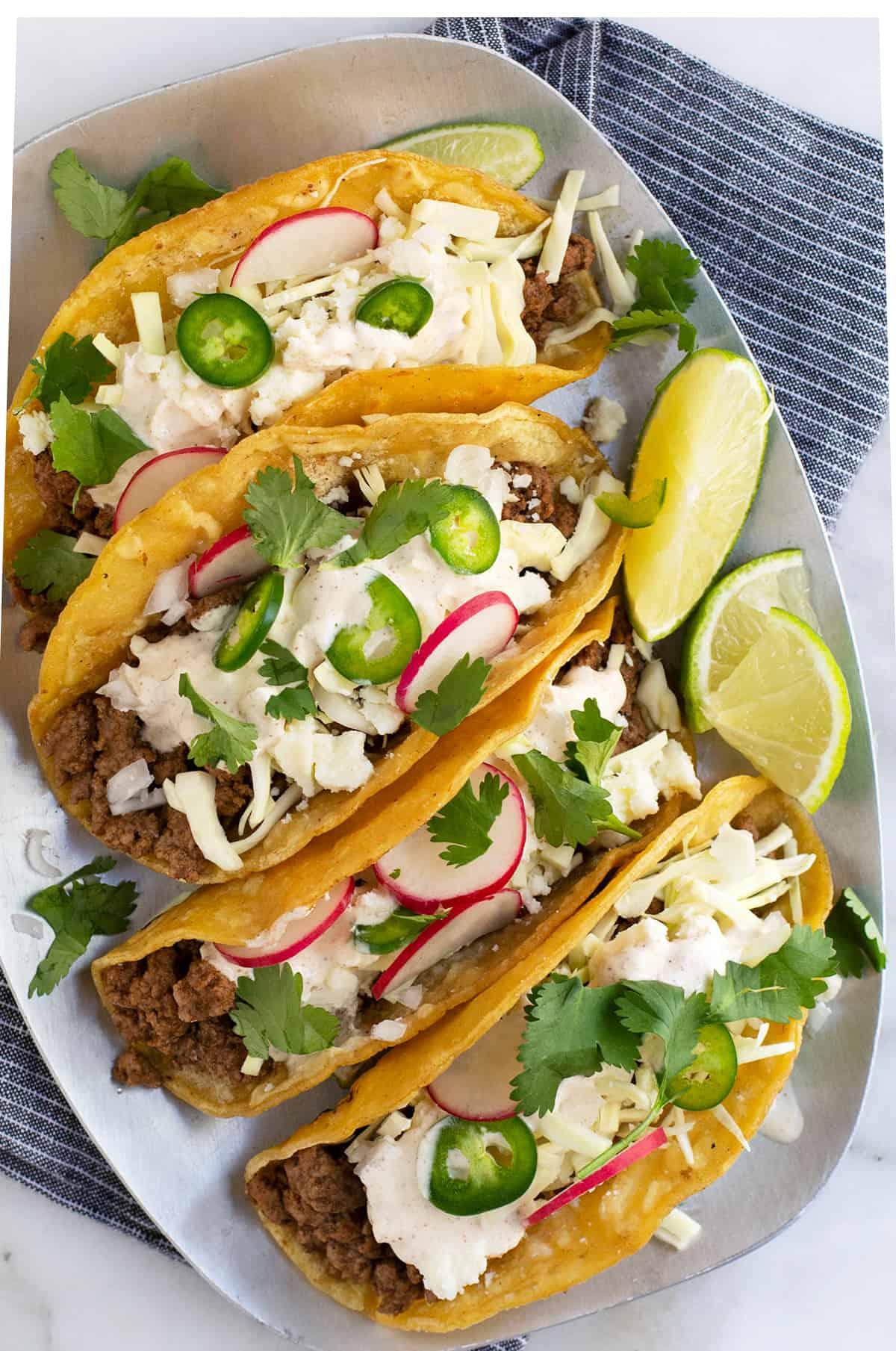 Lamb Tacos served on a steel platter