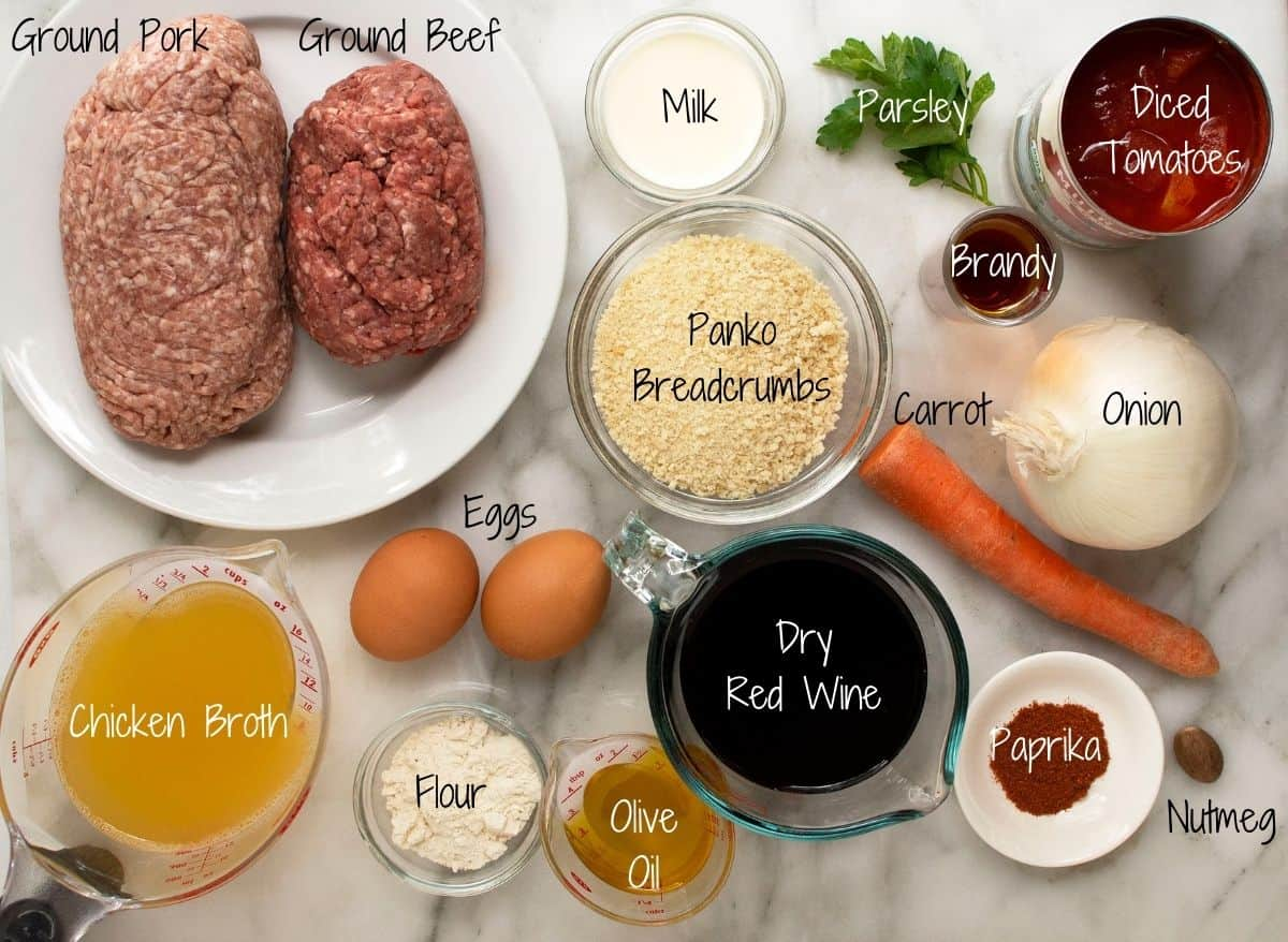Spanish Meatballs Ingredients on a white marble board