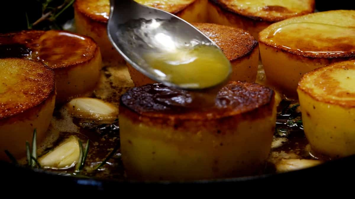 basting potatoes in skillet