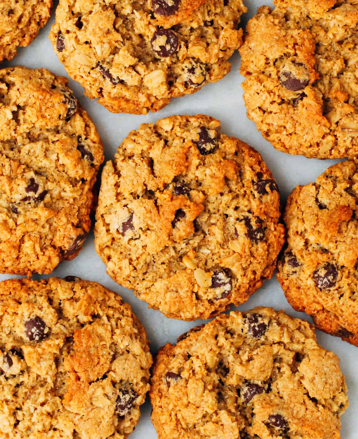 Almond Flour Oatmeal Cookies stacked on a white marble board photographed from above