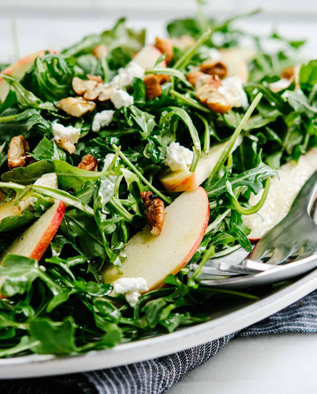 Arugula Apple Salad served on a white platter