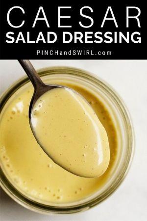 homemade caesar salad dressing on a spoon