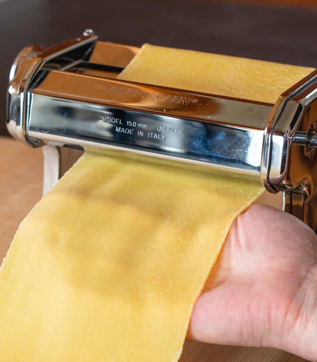 Final Pass of pasta dough through machine rollers