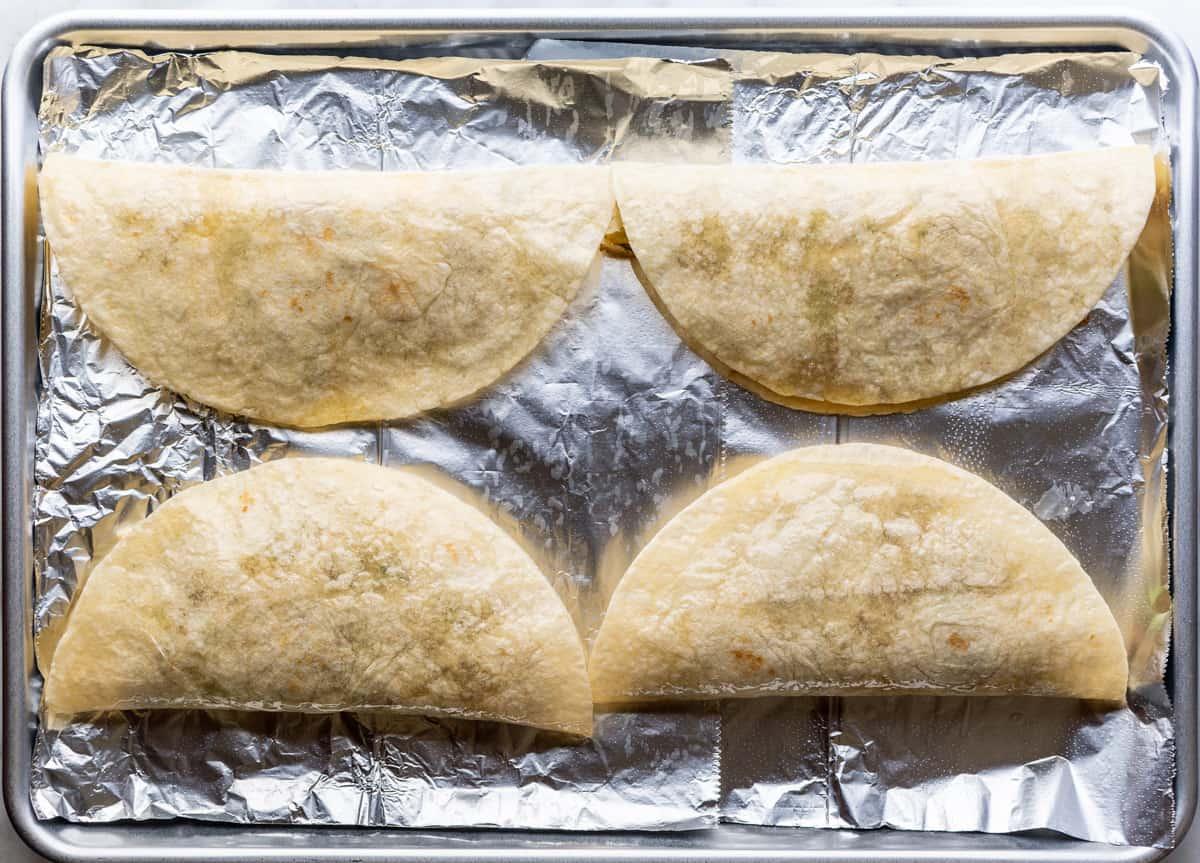 Pulled Pork Quesadillas on a baking sheet before baking