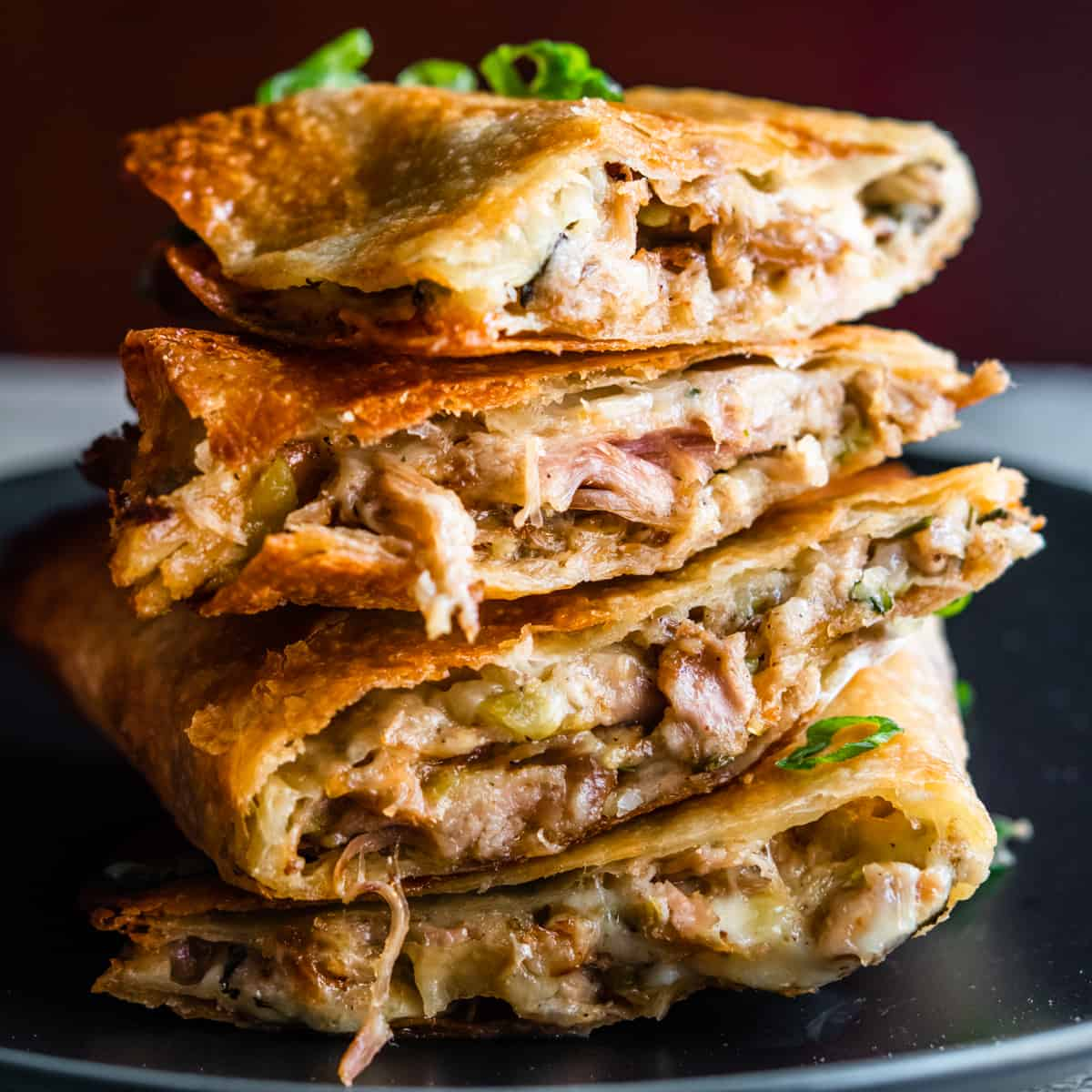 Pulled Pork Quesadillas stacked on a black plate