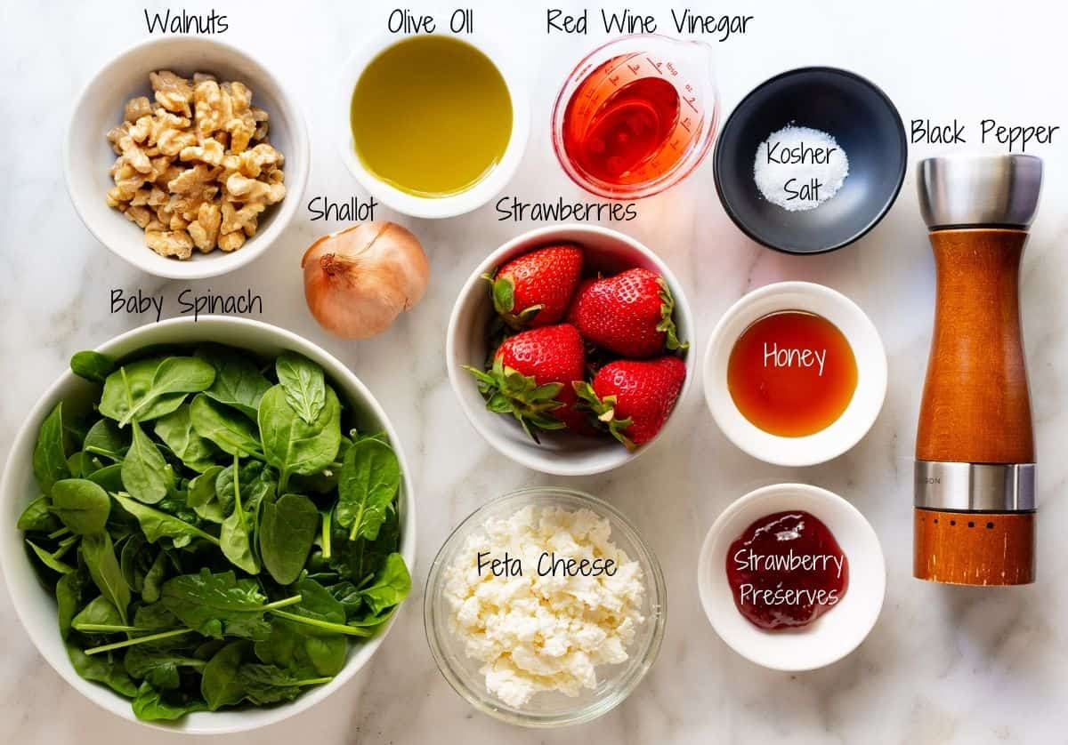 Spinach Strawberry Walnut Salad Ingredients on a white marble board