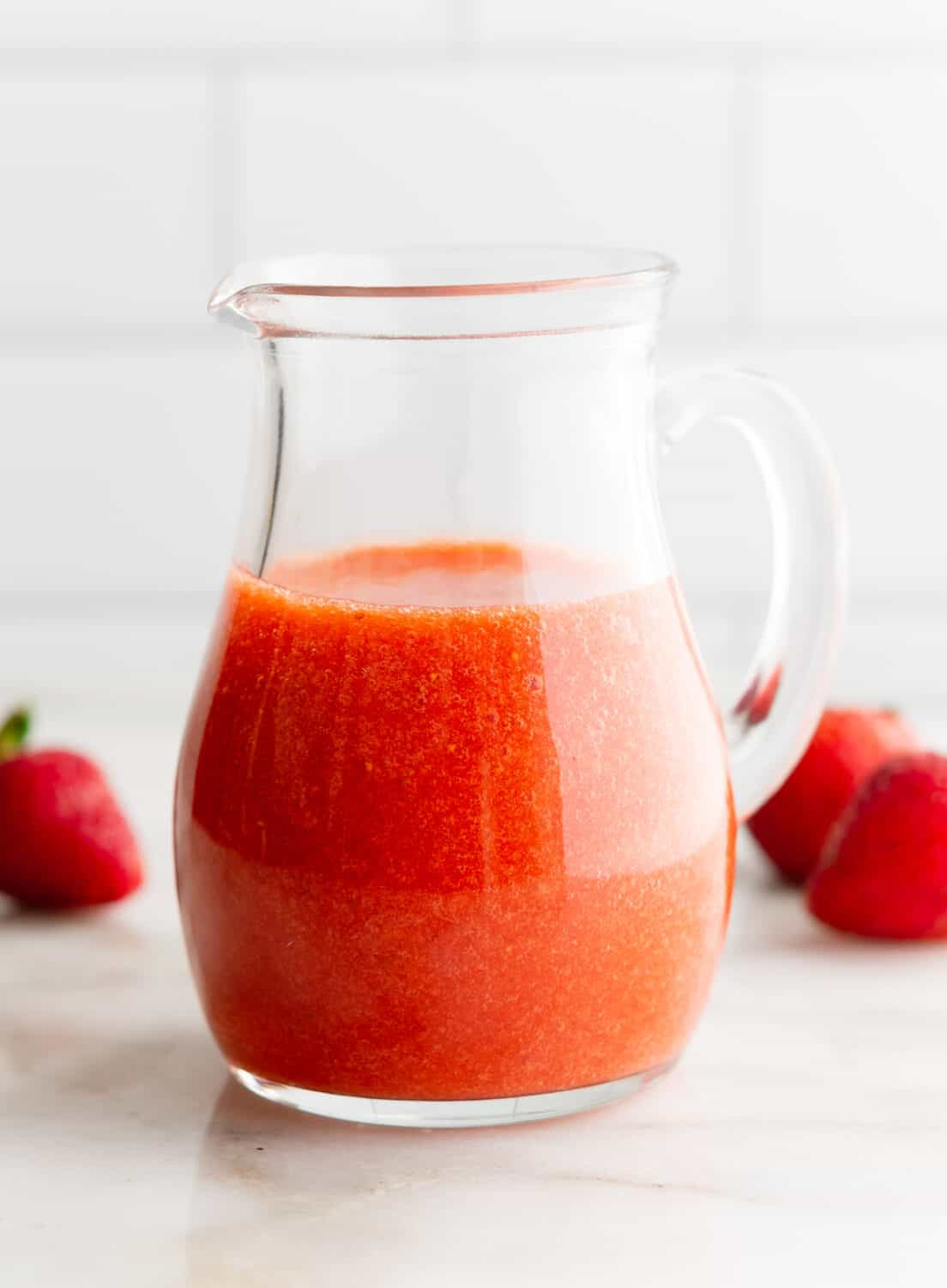Strawberry Vinaigrette in a clear glass pitcher