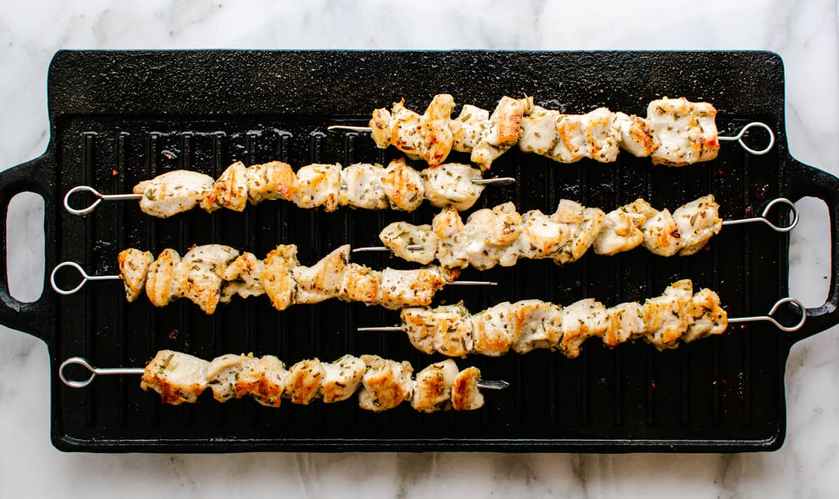 cooked chicken kabobs on grill pan