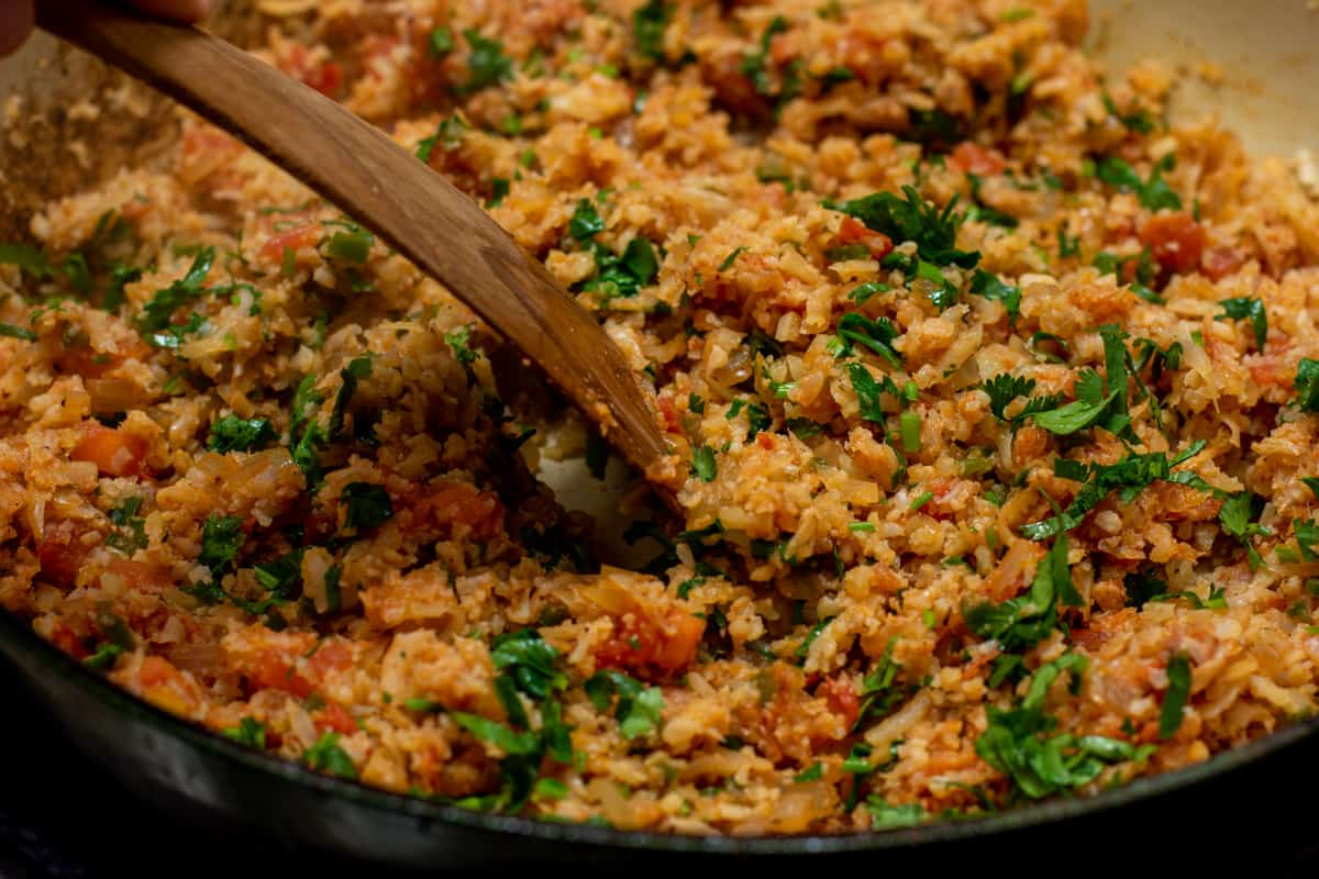 mexican cauliflower rice in the skillet ready to transfer to serving bowl