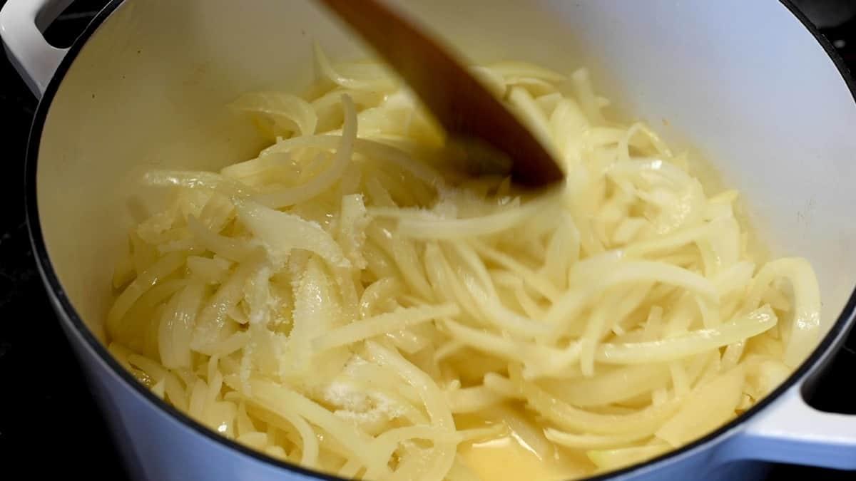 stirring sugar and salt into onions