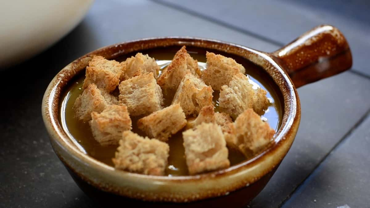 topping with toasted bread cubes