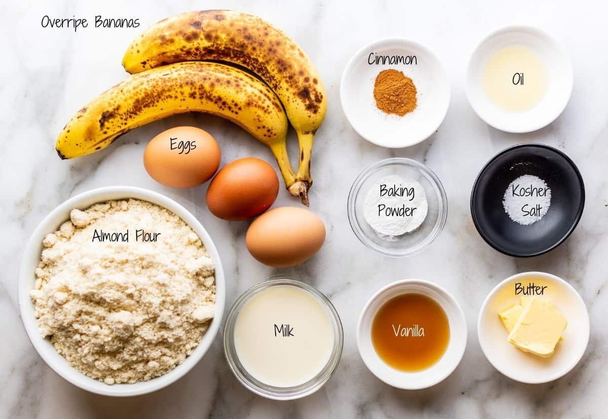 Almond Flour Banana Pancakes Ingredients on a white marble board