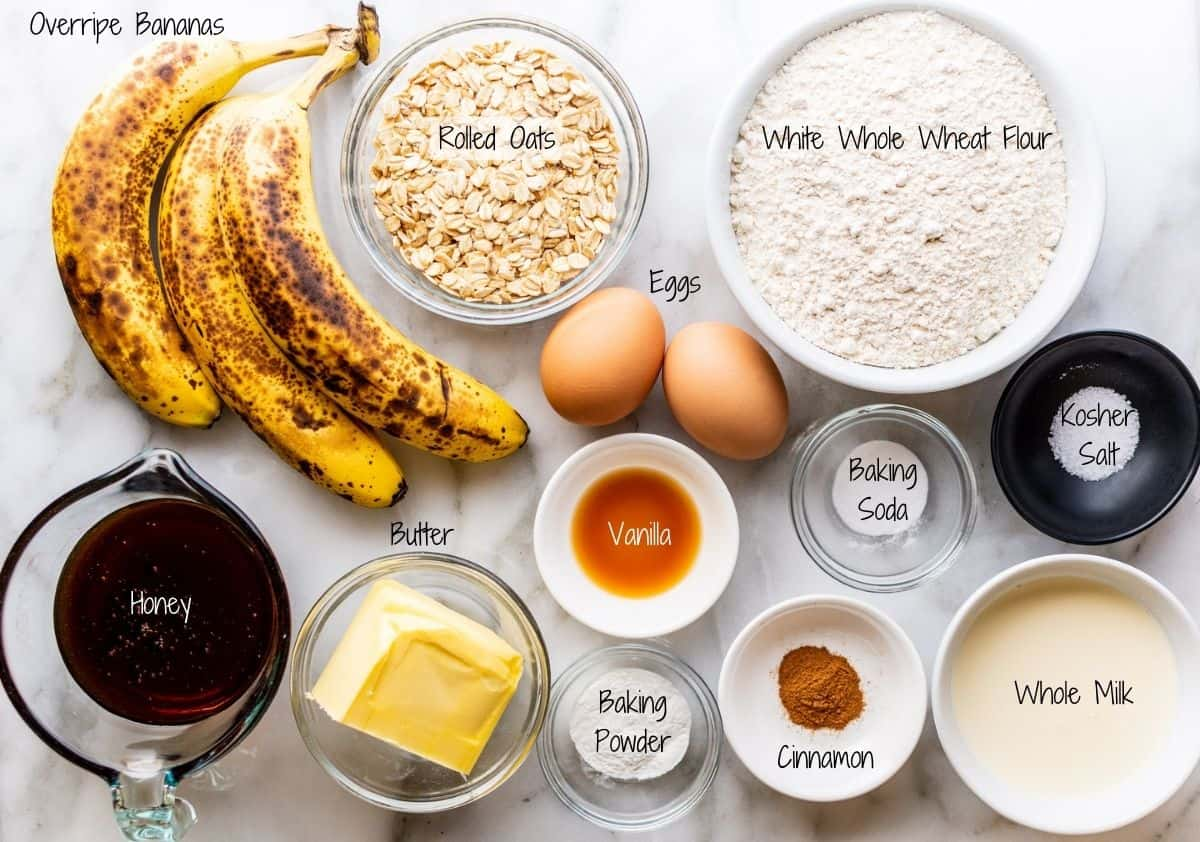 Banana Oatmeal Muffins Ingredients on a white marble board
