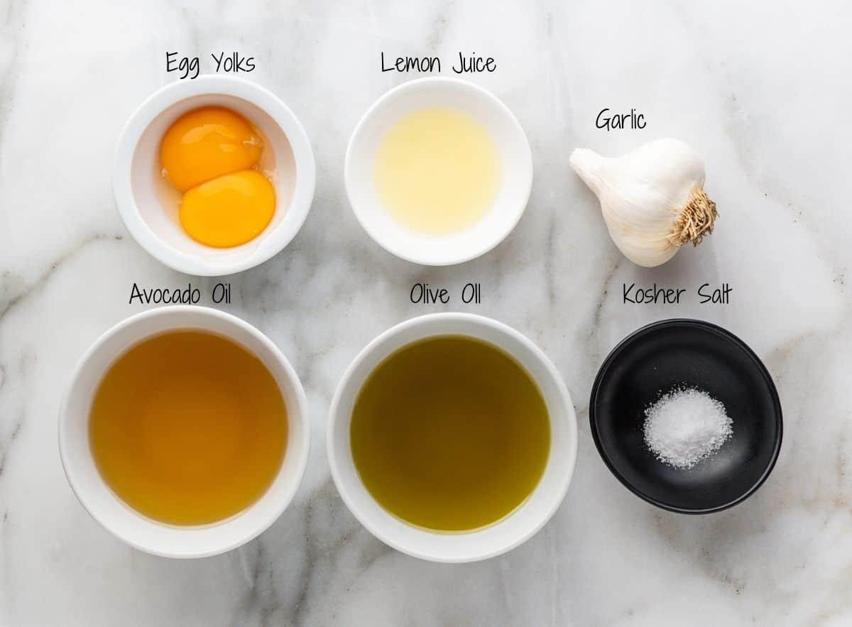 Garlic Aioli Ingredients on a white marble board