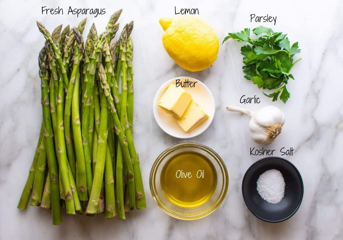 Lemon Garlic Asparagus Ingredients on a white marble board