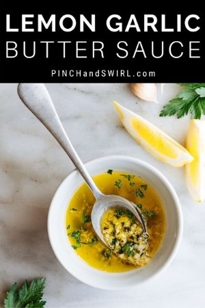 lemon garlic butter sauce on a spoon over a white bowl