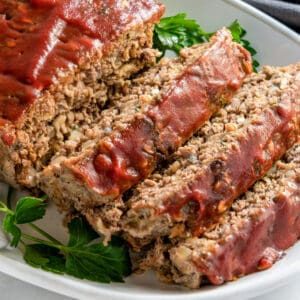 Meatloaf with Oatmeal close up slices on white platter