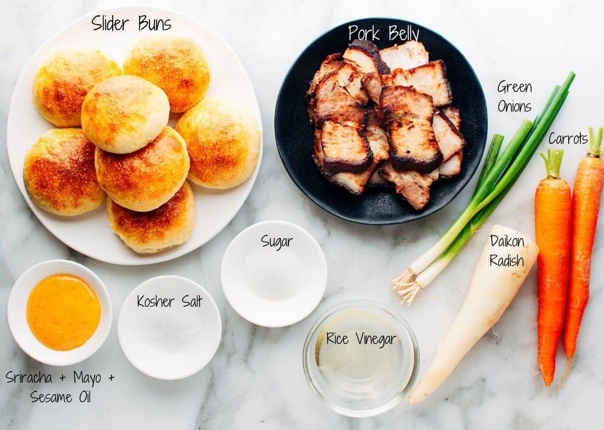 Pork Belly Sliders Ingredients on a white marble board