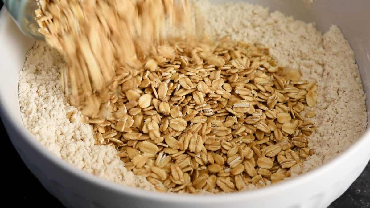 adding rolled oats to flour mixture