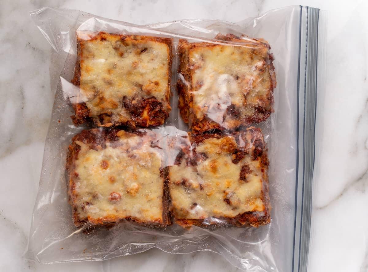 individual servings of frozen lasagna in a freezer bag