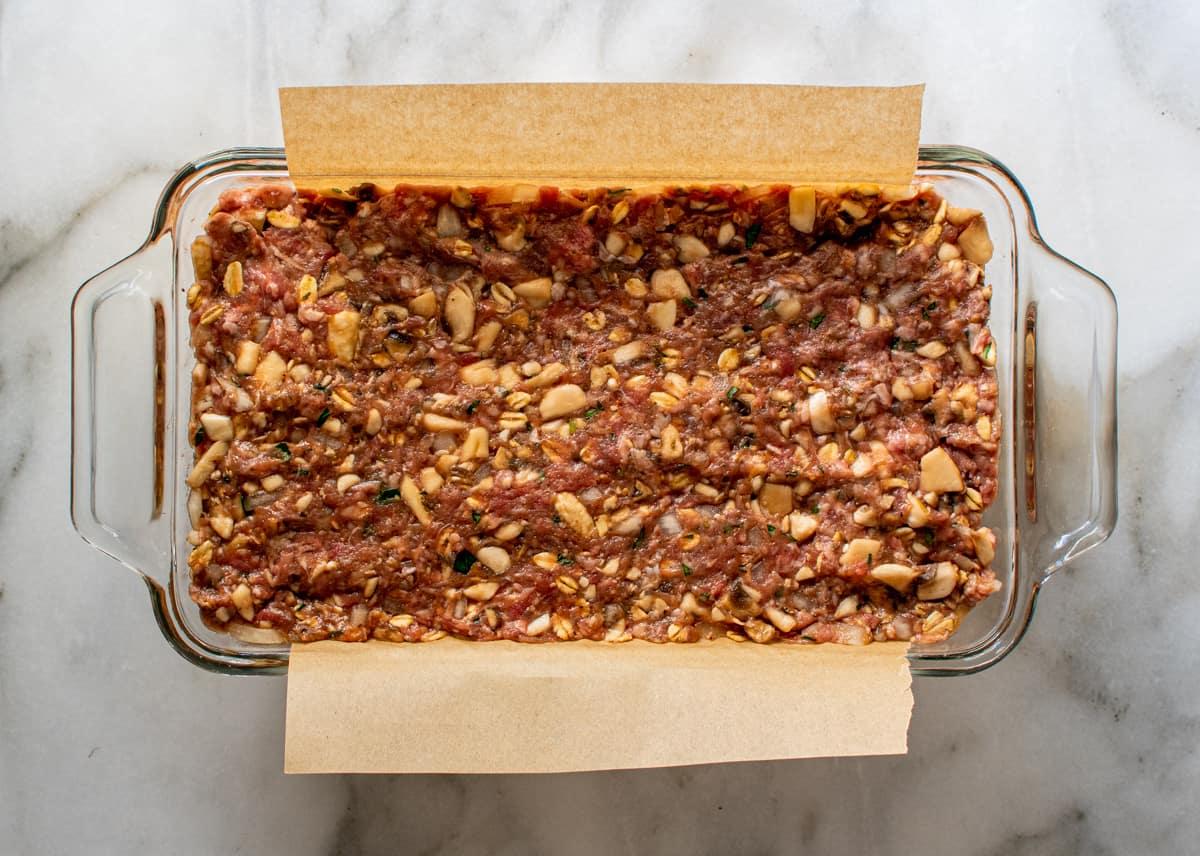 meatloaf mixture in glass loaf pan