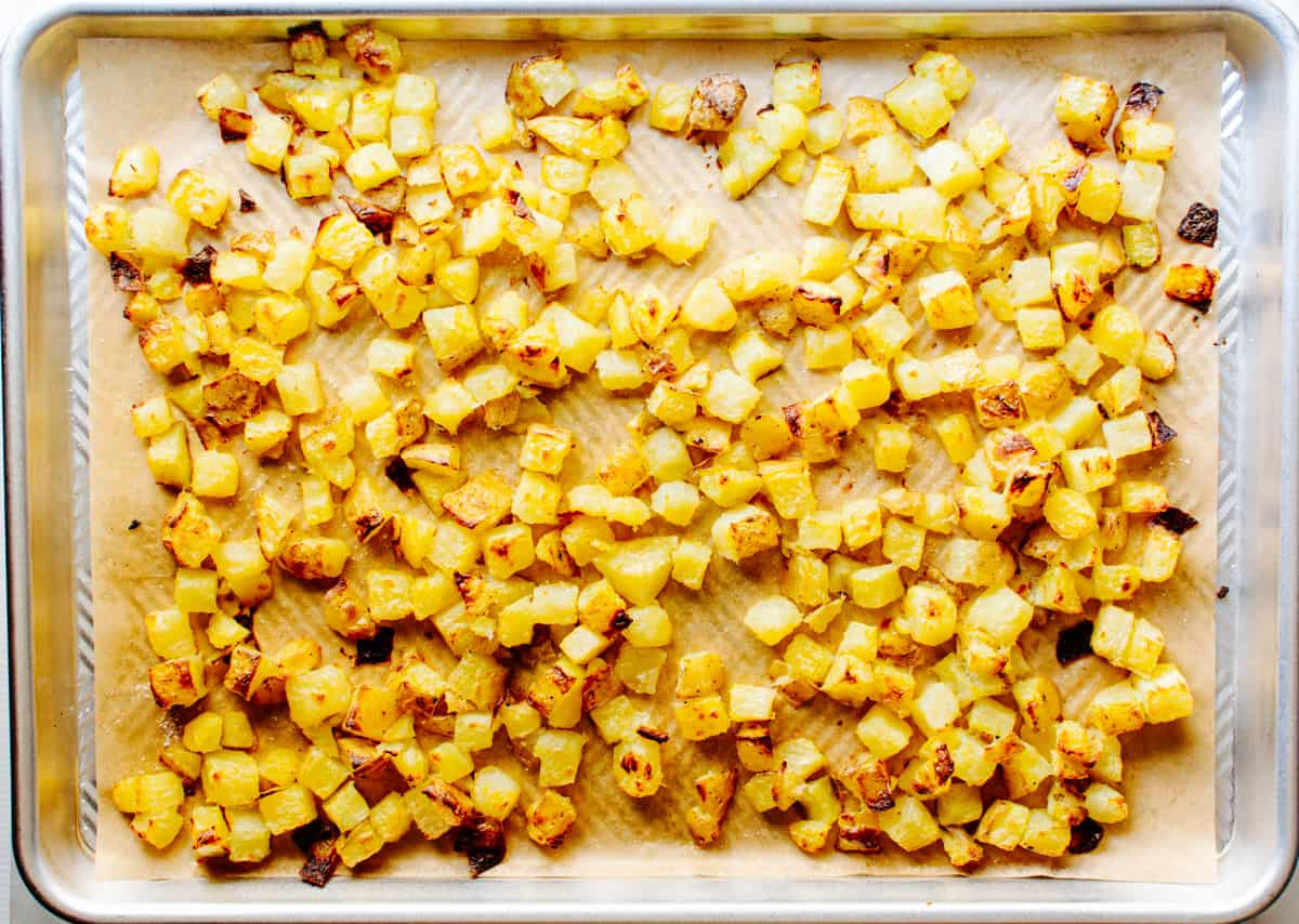 potatoes on a parchment lined baking sheet after roasting