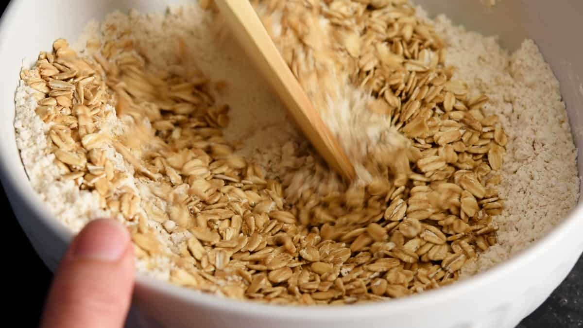 stirring in rolled oats to flour mixture