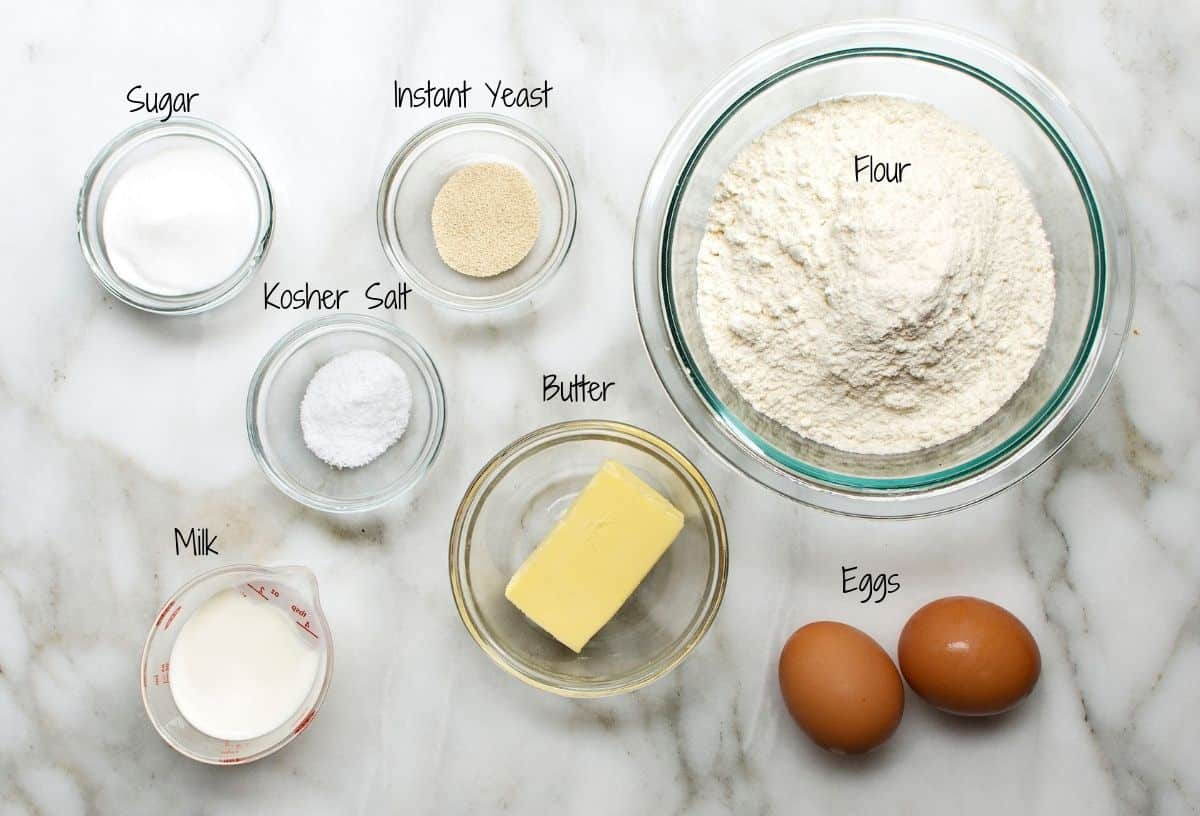Brioche Hot Dog Buns Ingredients on a white marble board