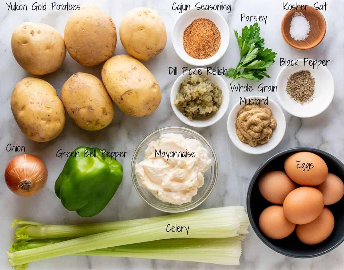 Cajun Potato Salad Ingredients on a white marble board