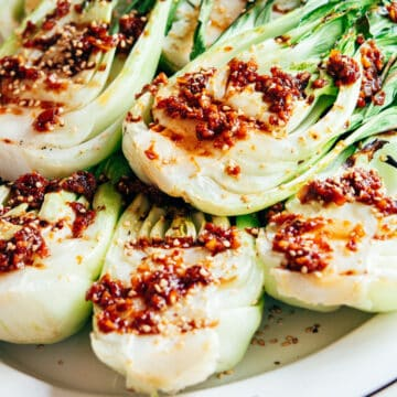 Grilled Baby Bok Choy on a white platter.