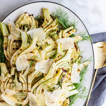 Grilled Fennel on an oval white platter photographed from above.