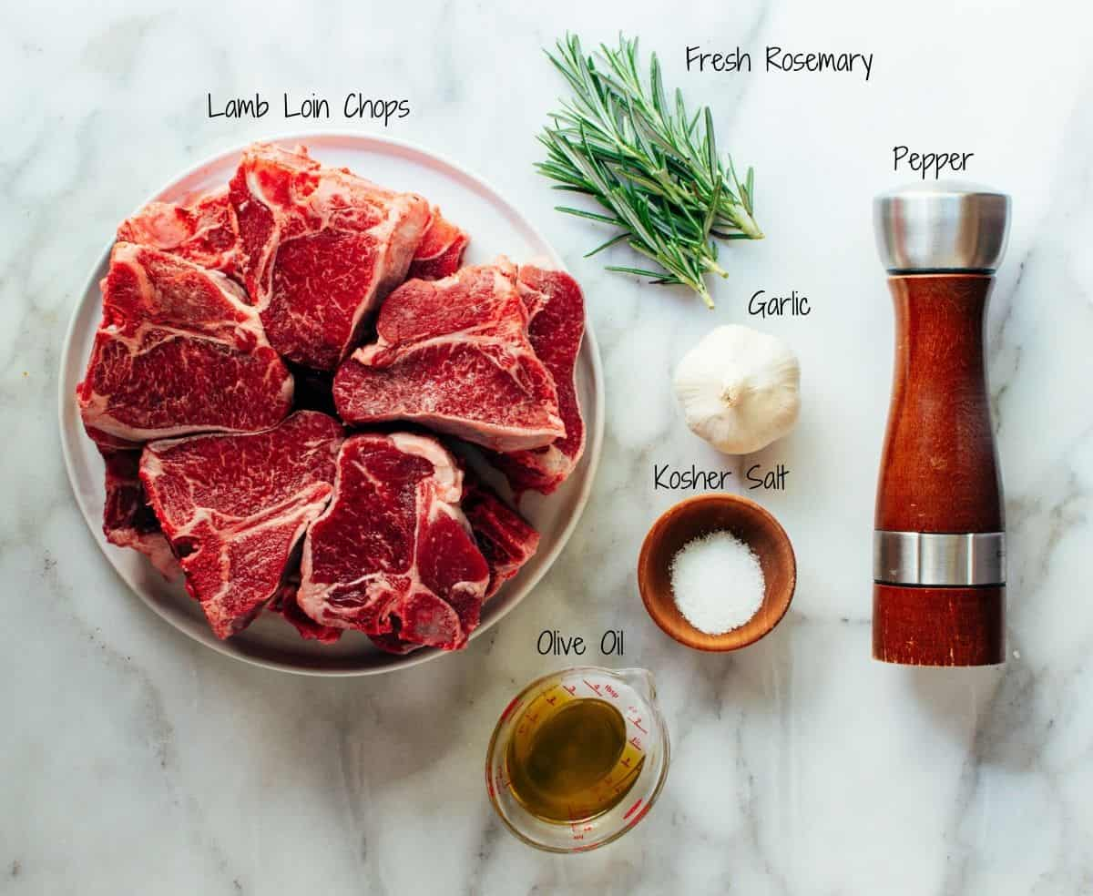 Grilled Lamb Chops Ingredients on a white marble board