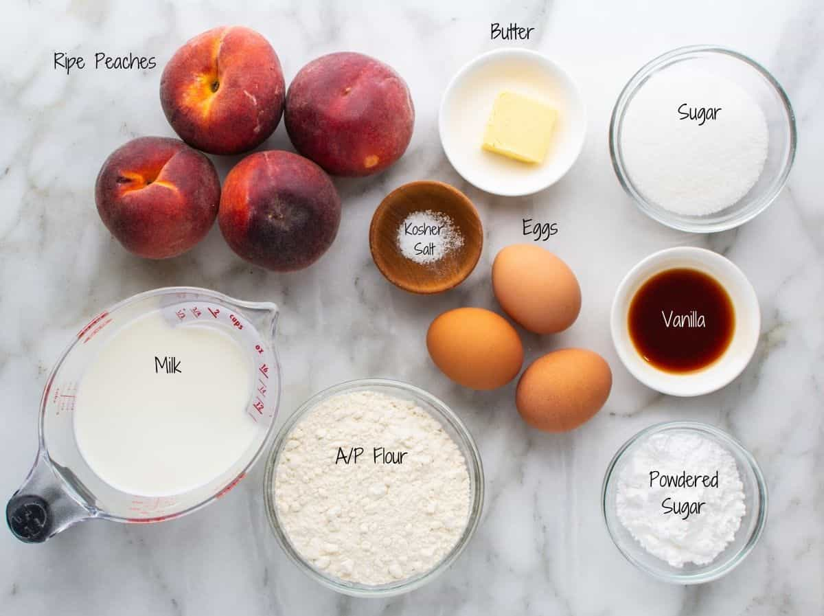 Peach Clafoutis Ingredients on a white marble board