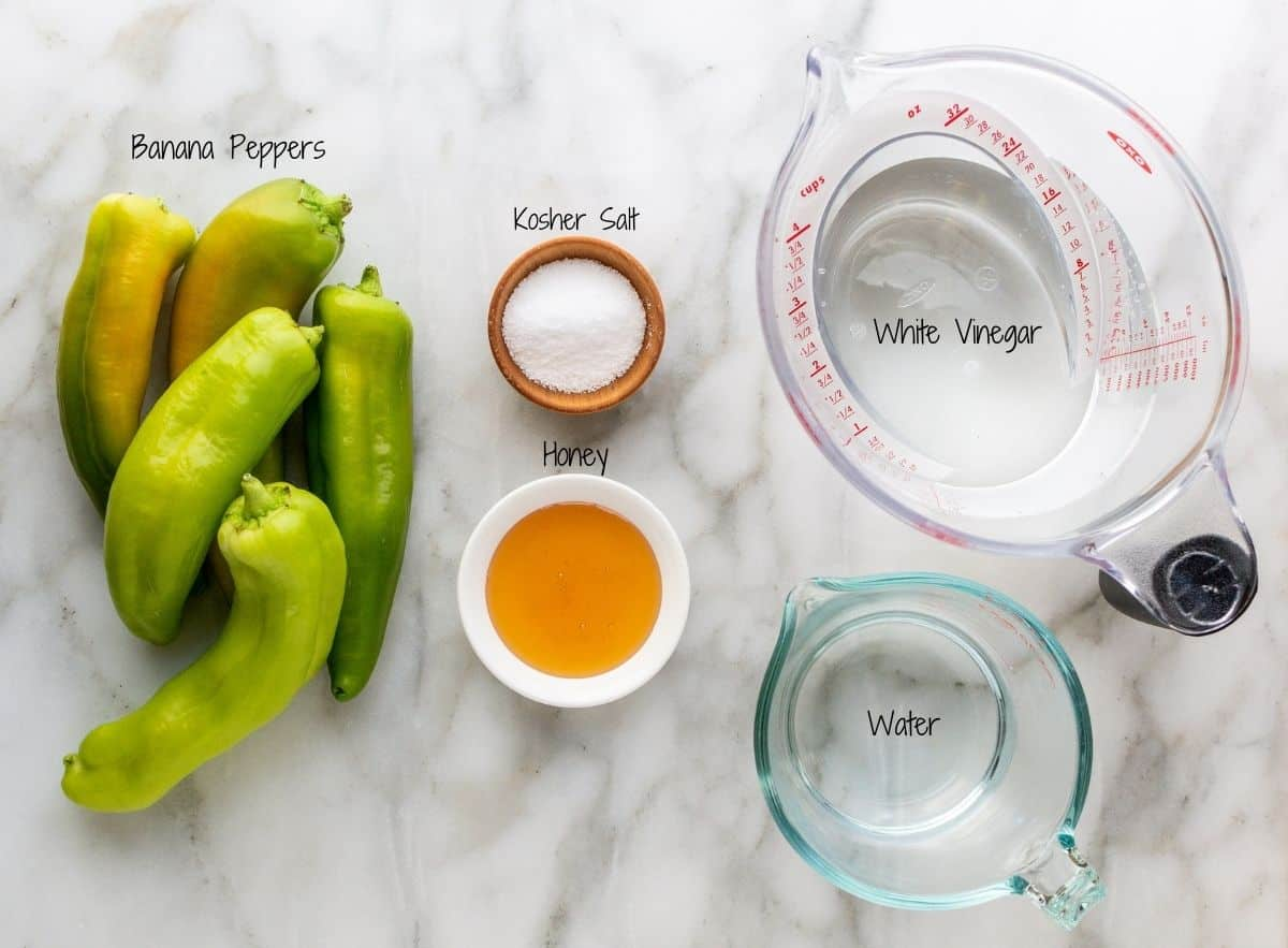 Pickled Banana Peppers Ingredients on a white marble board.